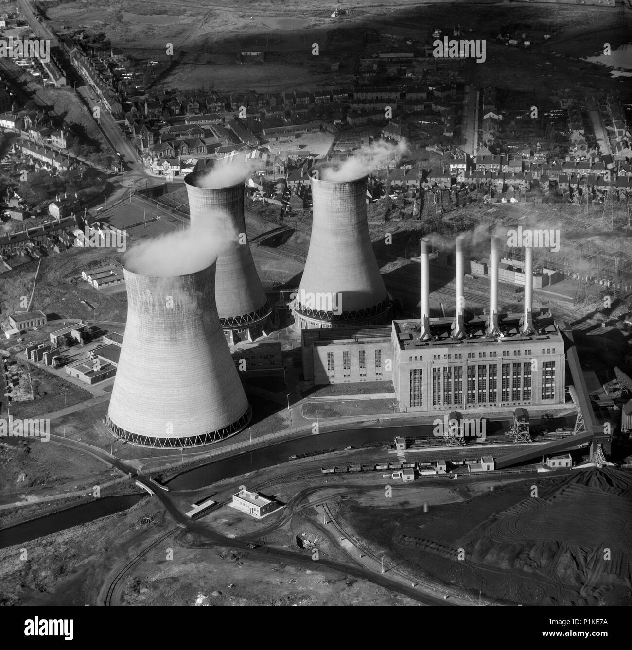 Ocker Hill Power Station, Tipton, Staffordshire, 1957. Aerial view of a coal-fired power station with three cooling towers emitting steam. It was open - Stock Image