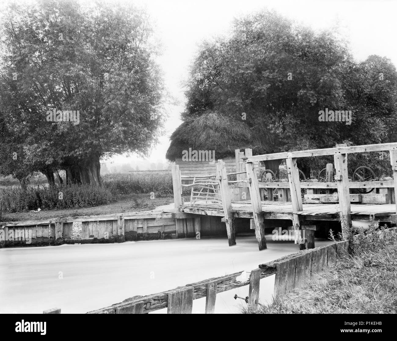 Old weir on the River Thames, Hurley, Berkshire, c1860-c1922. The mechanism on the top of the weir may be to control the flow of water through the wei - Stock Image