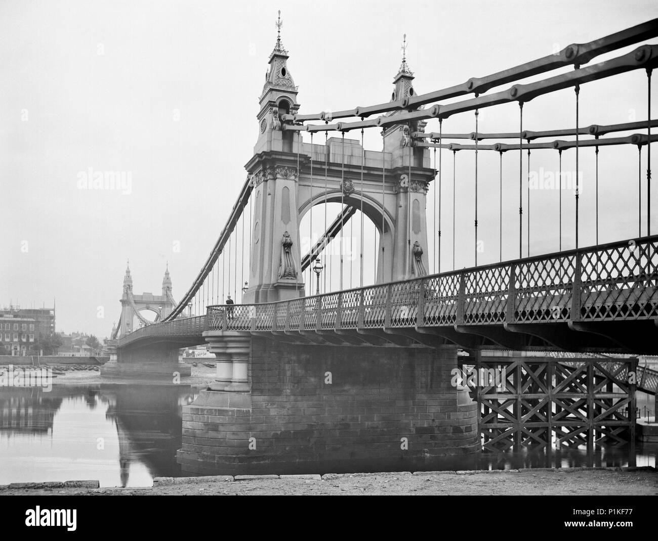 Hammersmith Bridge, Barnes, London, 1895. This decorative suspension bridge is seen here from the riverbank. It was built in 1887, designed by Sir Jos - Stock Image