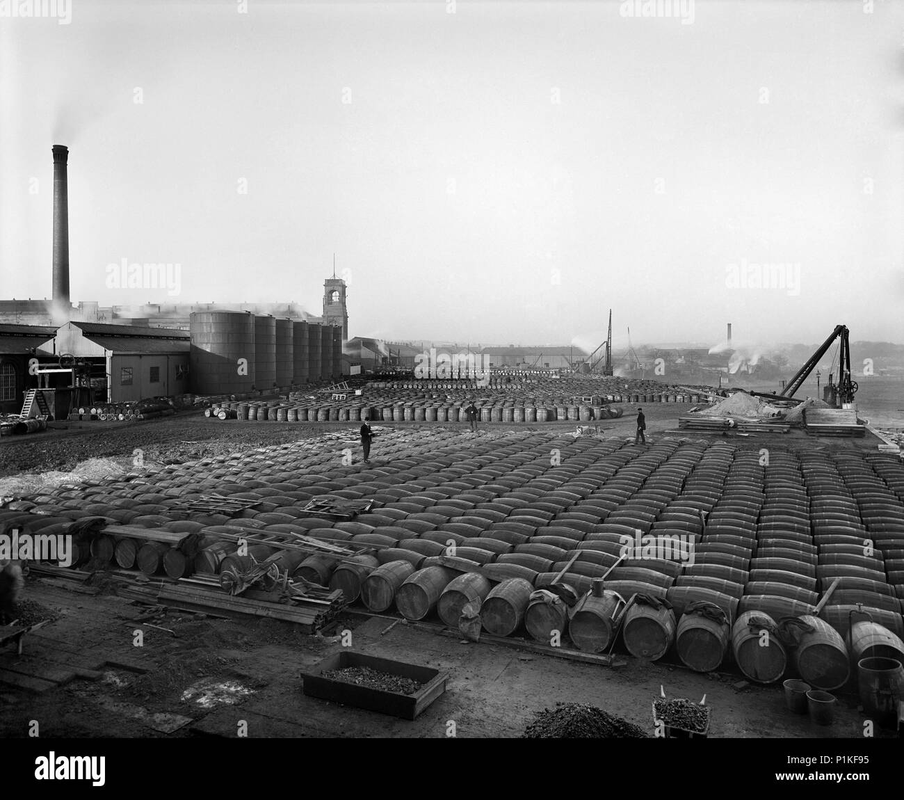 Lever Brothers Sunlight Soap Works, Port Sunlight, Wirral, Merseyside, 1897. Thousands of barrels of tallow and other soap ingredients stacked in rows - Stock Image