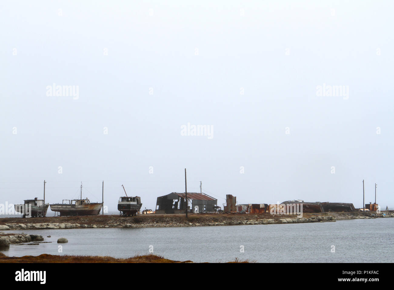 Fishing boat graveyard at Flowers Cove, Newfoundland, Canada - Stock Image