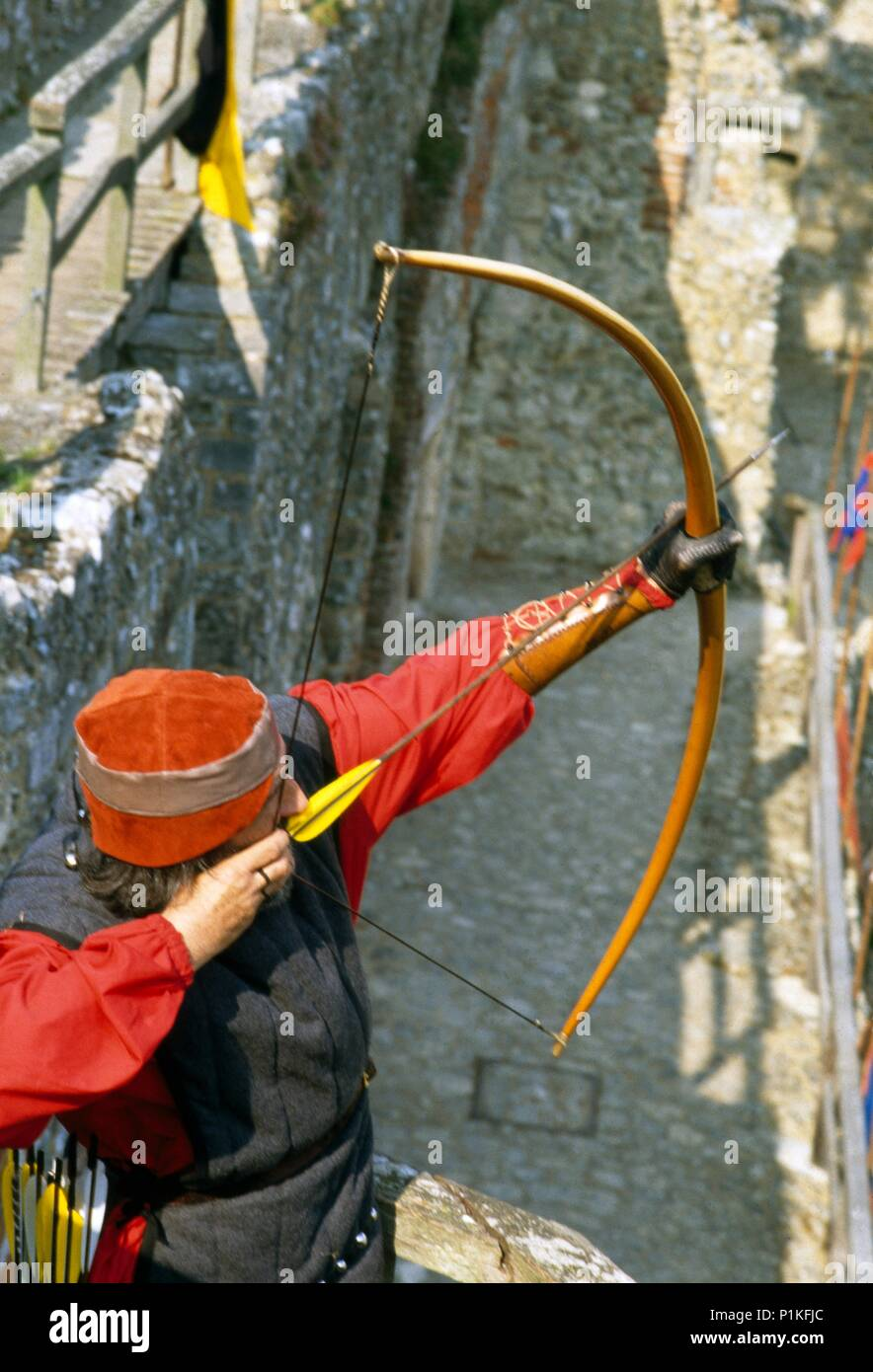 Re-enactment event at Carisbrooke Castle, Isle of Wight, c1980-c2017. An archer with bow and arrow on the battlements. - Stock Image