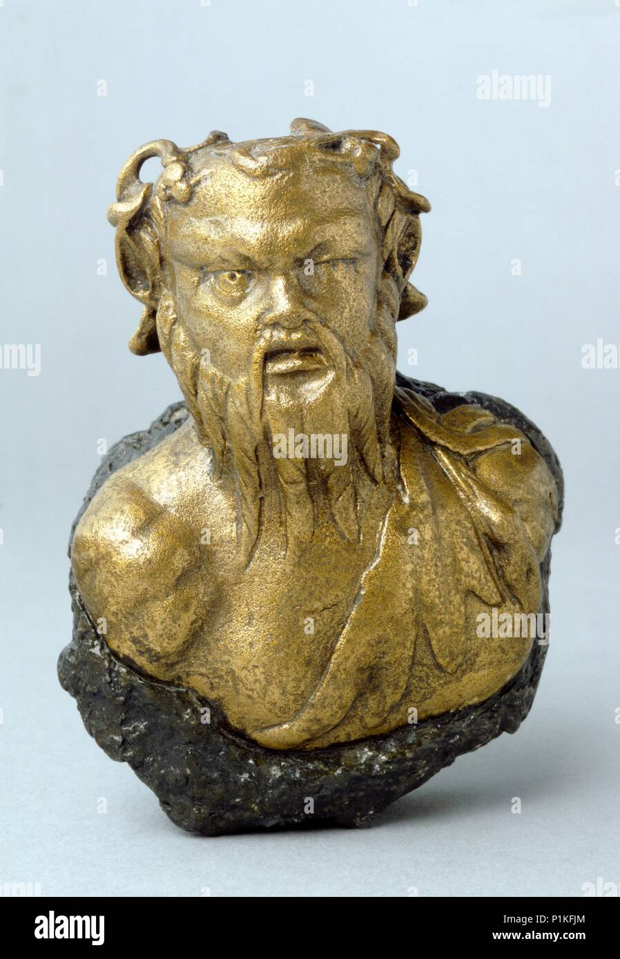 Roman steelyard weight in the form of a bearded satyr, found at Richborough Castle, Kent. - Stock Image