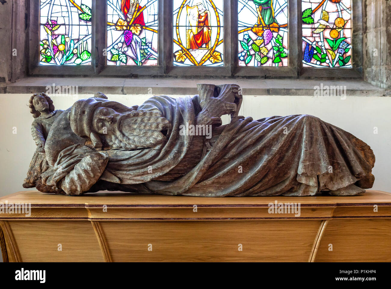 The Jesse, a 15th century wooden carving which once formed part of a 'Jesse Tree' showing the lineage of Christ from Jesse,  the father of David, Priory Church of St Mary, Abergavenny, Monmouthshire, Wales, UK. - Stock Image