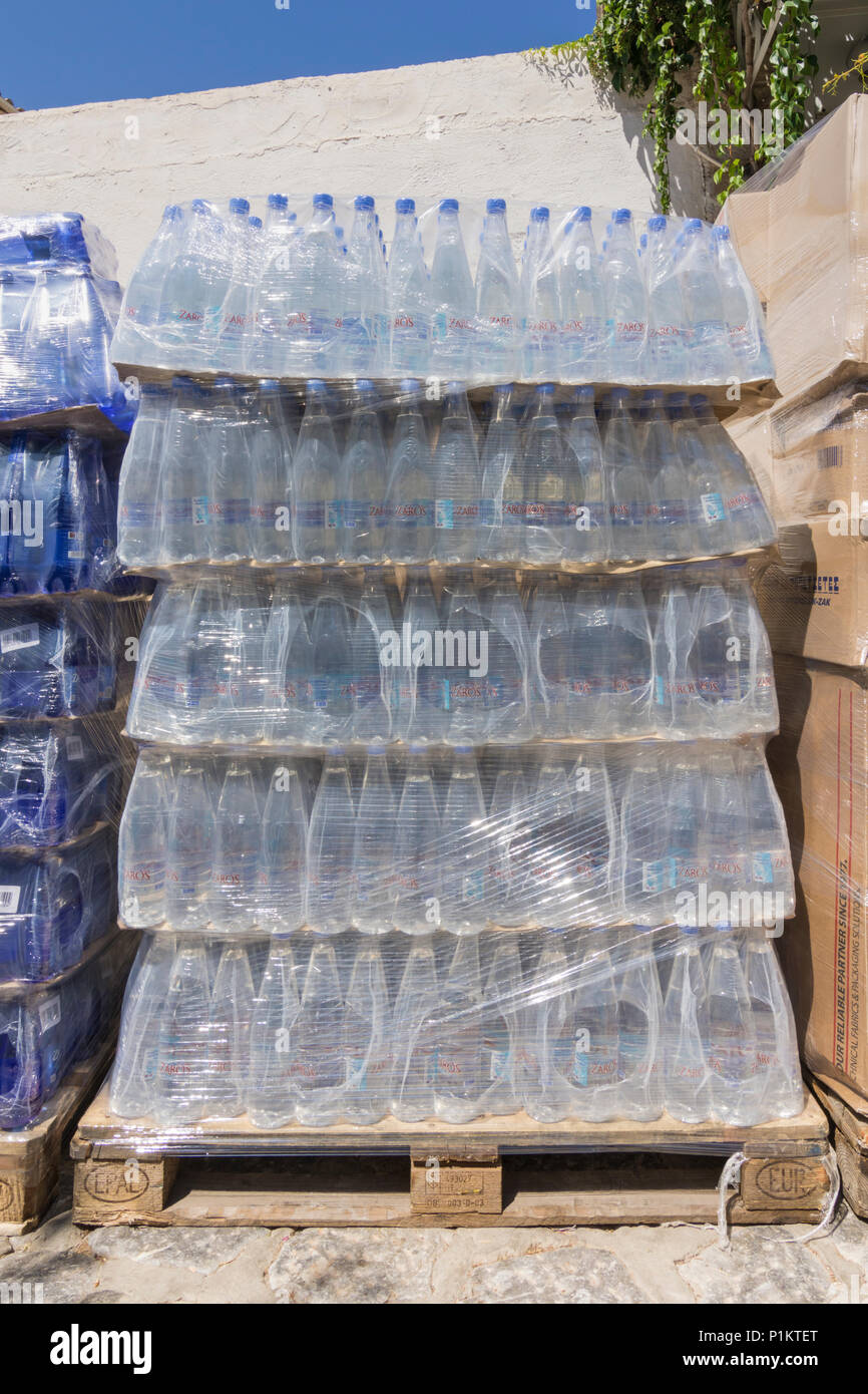Crates of plastic water bottles in Greece - Stock Image
