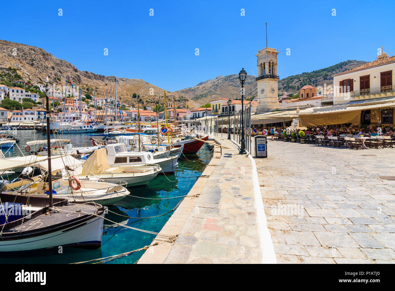 Hydra's cafe lined waterfront, Hydra Town, Hydra, Greece - Stock Image
