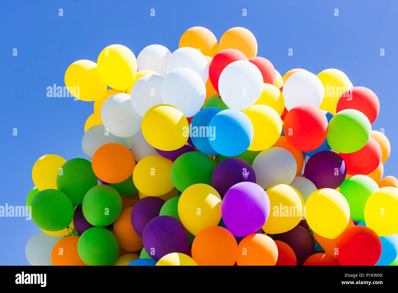 background of a set of colored balloons on the sky background stock