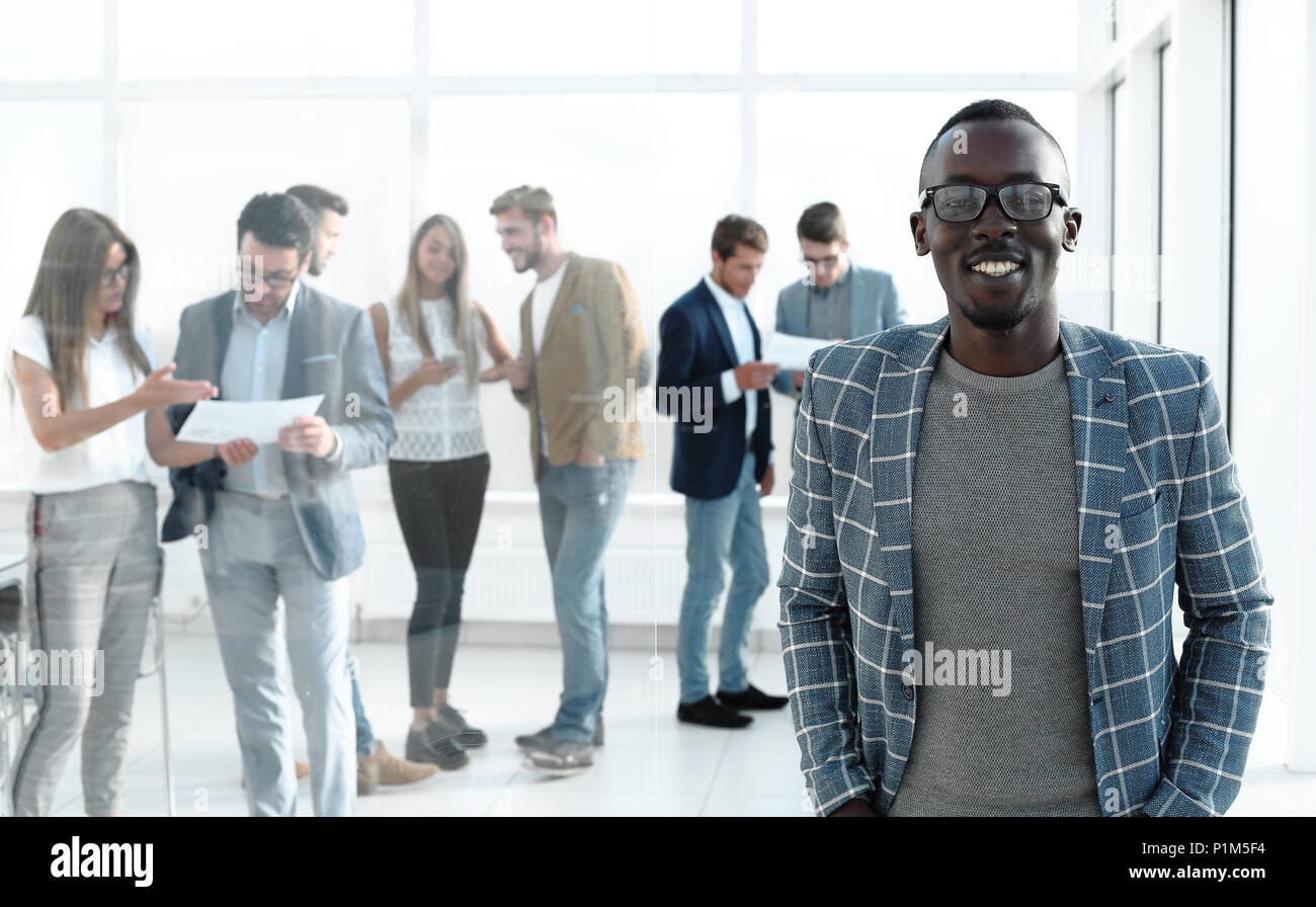 businessman standing in the hall of the modern office - Stock Image