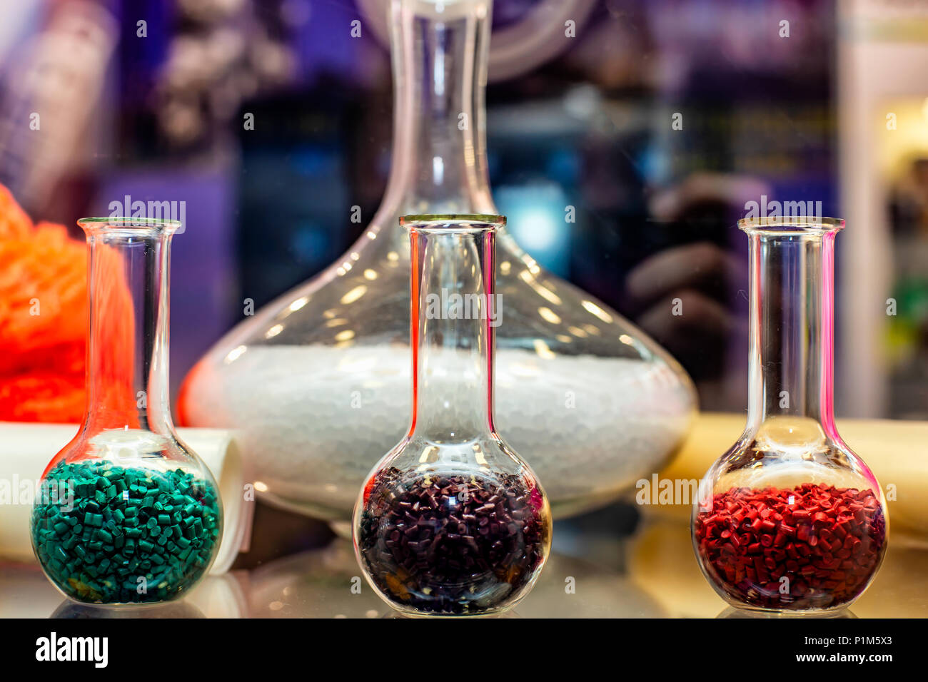 Polymeric dye. Plastic pellets. Colorant for plastics. Pigment in the granules. Polymer beads - Stock Image