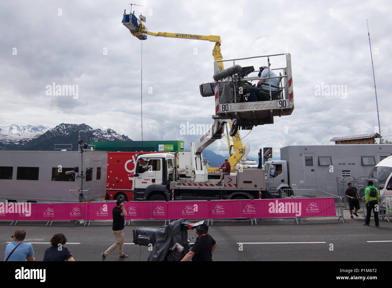 A cameraman on a platform crane filming the finish line at the Criterium du Dauphiné 2018 Stage 6 La Rosière Avergne Rhone Alpes Savoie Stock Photo