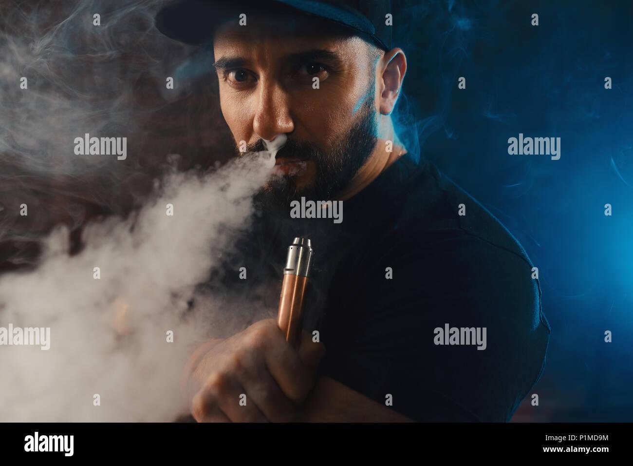 Man vaping an electronic cigarette - Stock Image