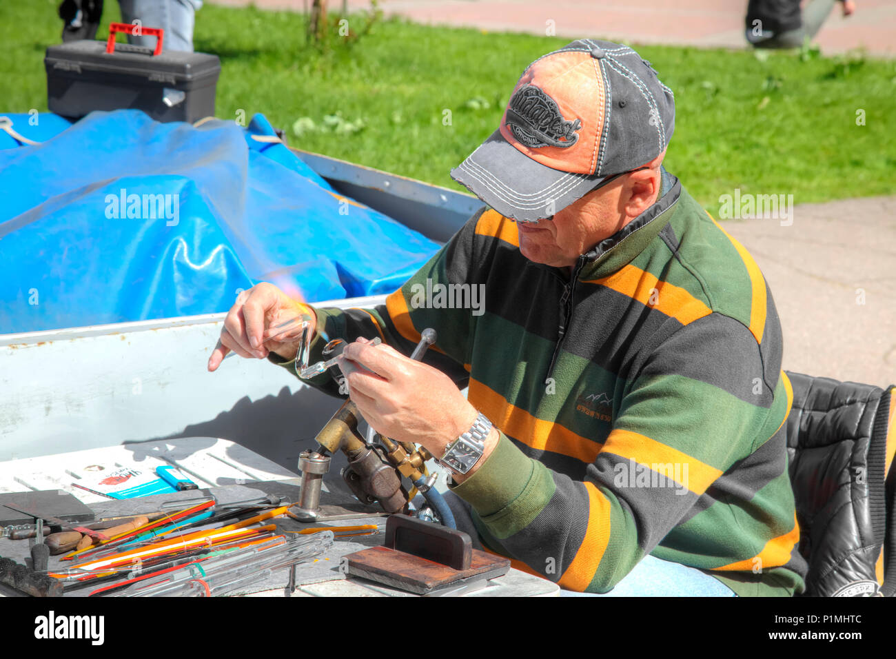 KALININGRAD, RUSSIA - May 04.2018: The master of glassblower makes glass souvenirs for sale - Stock Image