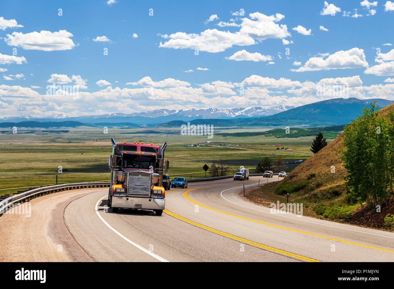 Tractor trailer on highway 285 with South Park valley beyond; from Kenosha Pass; central Colorado; USA Stock Photo
