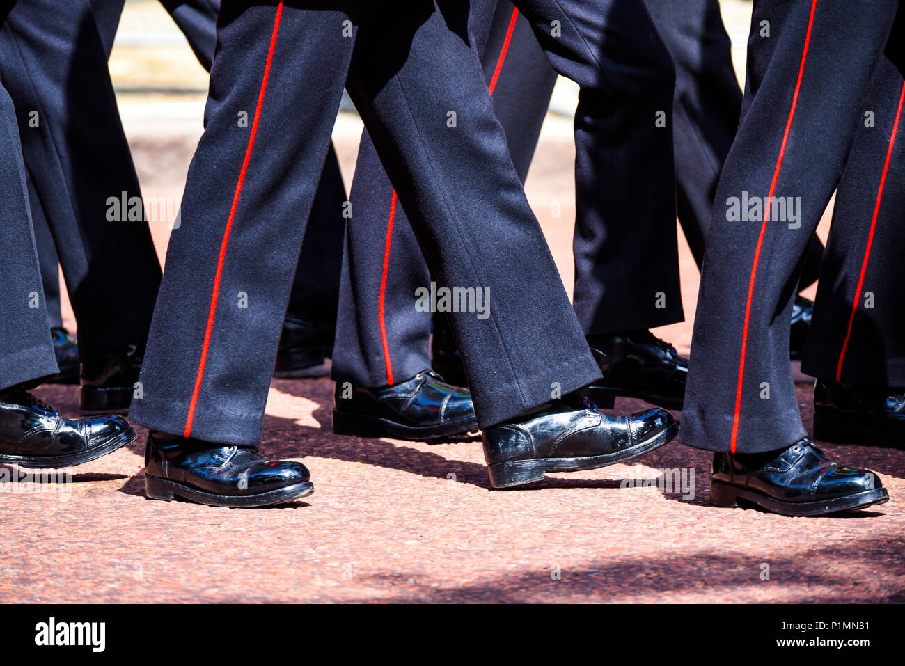 Marching legs. Trooping the Colour 2018. British Army Coldstream Guards marching legs and polished boots. On red surface of The Mall, London, UK - Stock Image