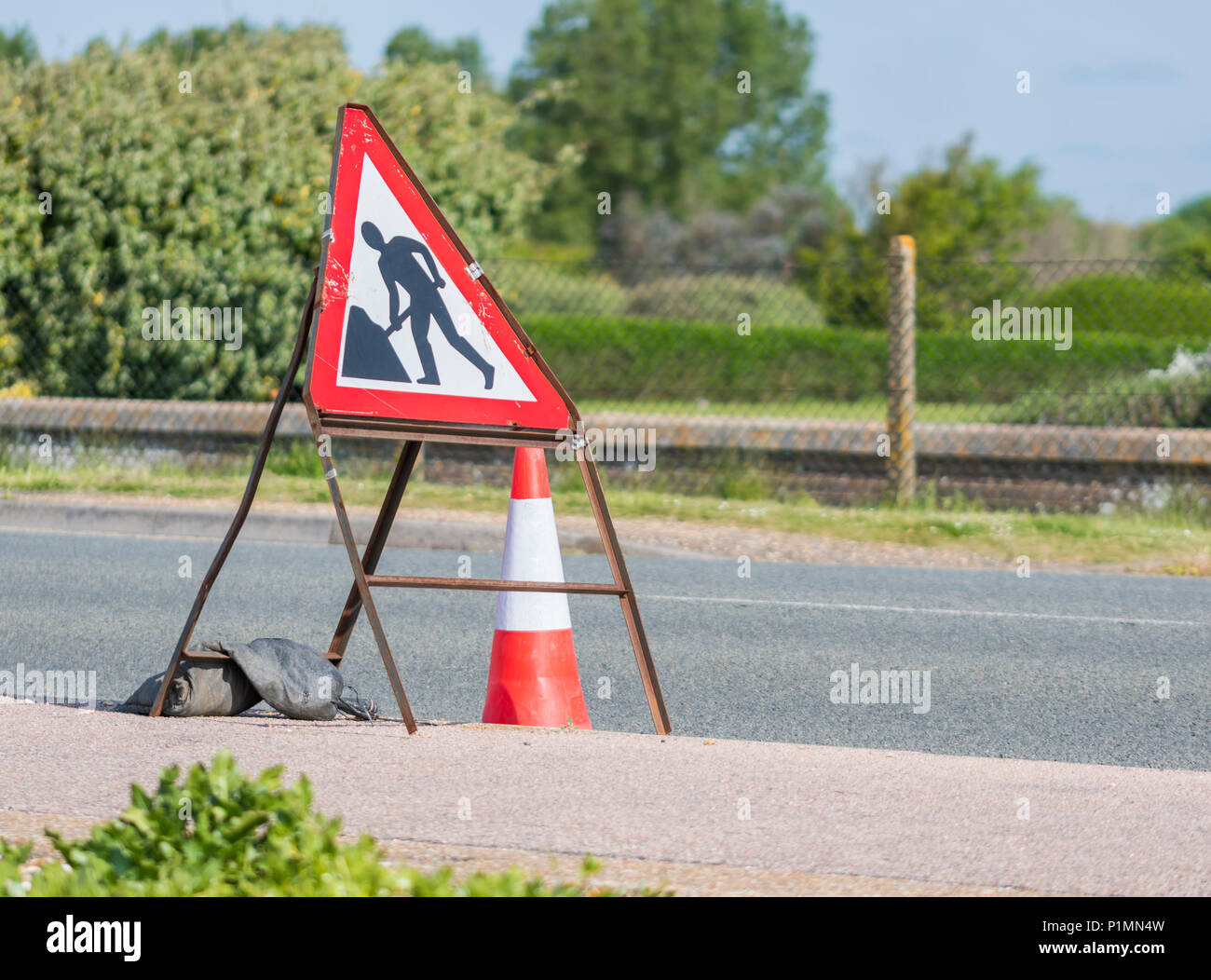 Triangular portable temporary roadworks warning sign in the UK. - Stock Image