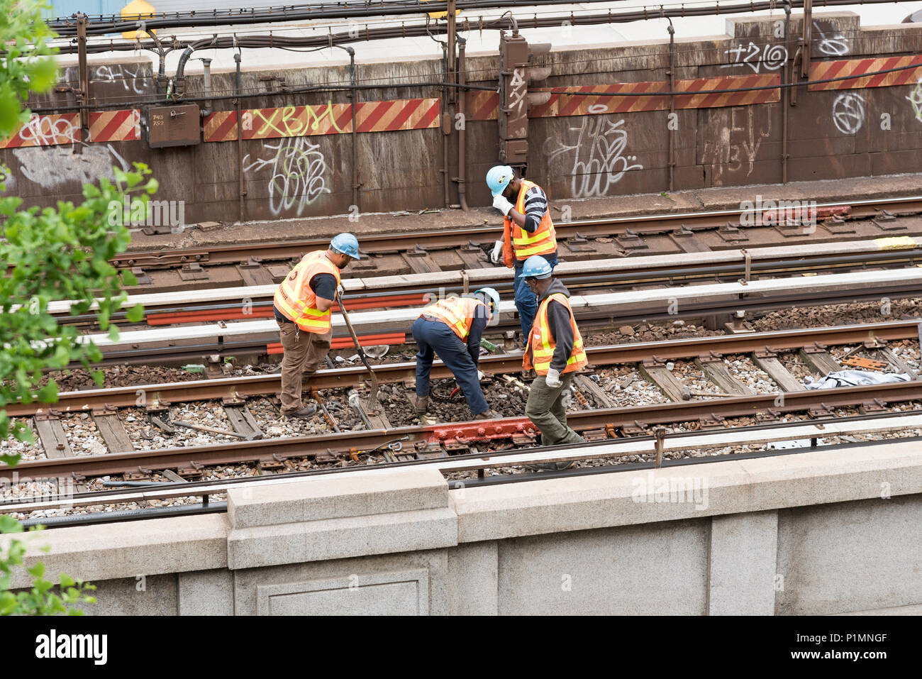 126th Street New York USA. Railroad workers working on the track. 2018 Stock Photo