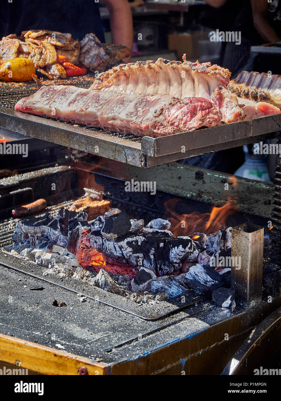 Pork Spare Ribs On A Charcoal Bbq In A Stall Of A Street Food Fair Stock Photo Alamy