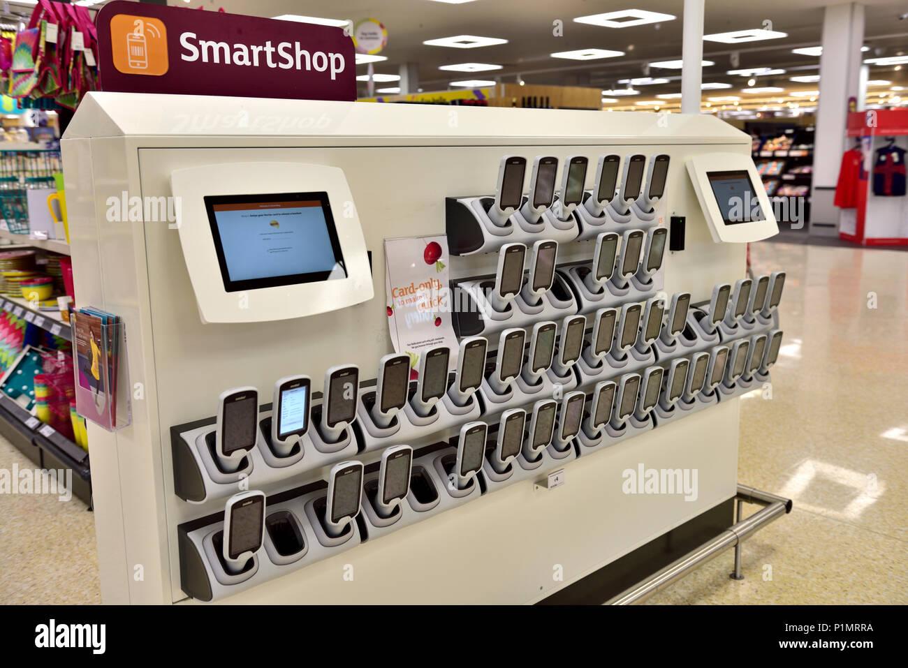 Bank of Sainsbury's SmartShop in store handsets on handset wall - Stock Image