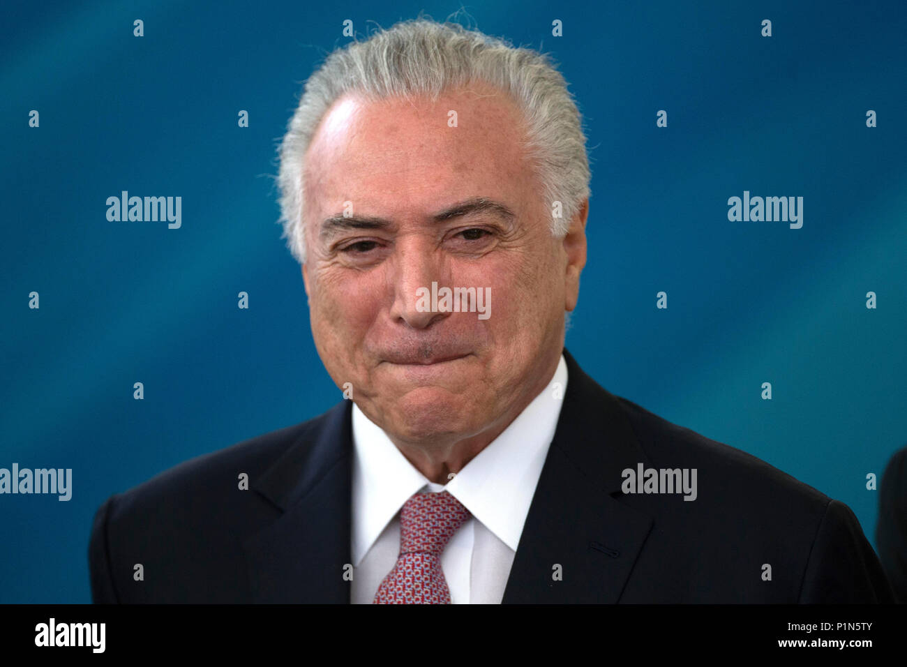 Brasilia, Brazil. 12th June, 2018. Brazilian President Michel Temer takes part in a ceremony to sign decrees in order to regulate the Mining Code and the revenue law for Financial Compensation on the Explotation of Mineral Resources, in Brasilia, Brazil, 12 June 2018. Temer imposed new rules for the mining activity which include the increase of the environmental responsibility of the companies that operate in the sector. Credit: Joedson Alves/EFE/Alamy Live News - Stock Image