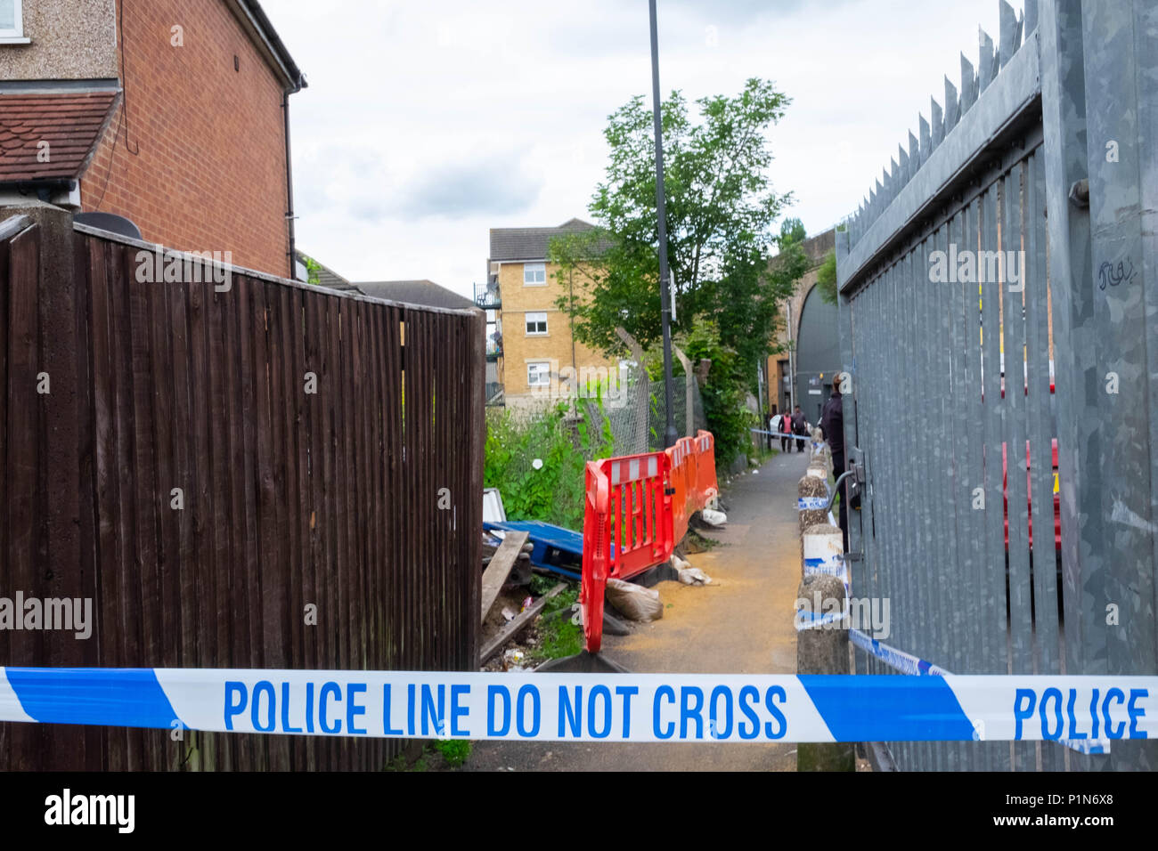 South Harrow, London, England. 12th June 2018. Police search for clues and protect the scene of the latest violent incident in Harrow, contributing to the continuous violent crime rates in London. The location is very close to recent stabbing of a 17 year old and is part of the same investigation.  The Police would only say that someone had been very badly injured. They were undertaking a finger tip search of the crime scene on Roxeth Green Avenue, South Harrow. Credit © Tim Ring/Alamy Live News - Stock Image