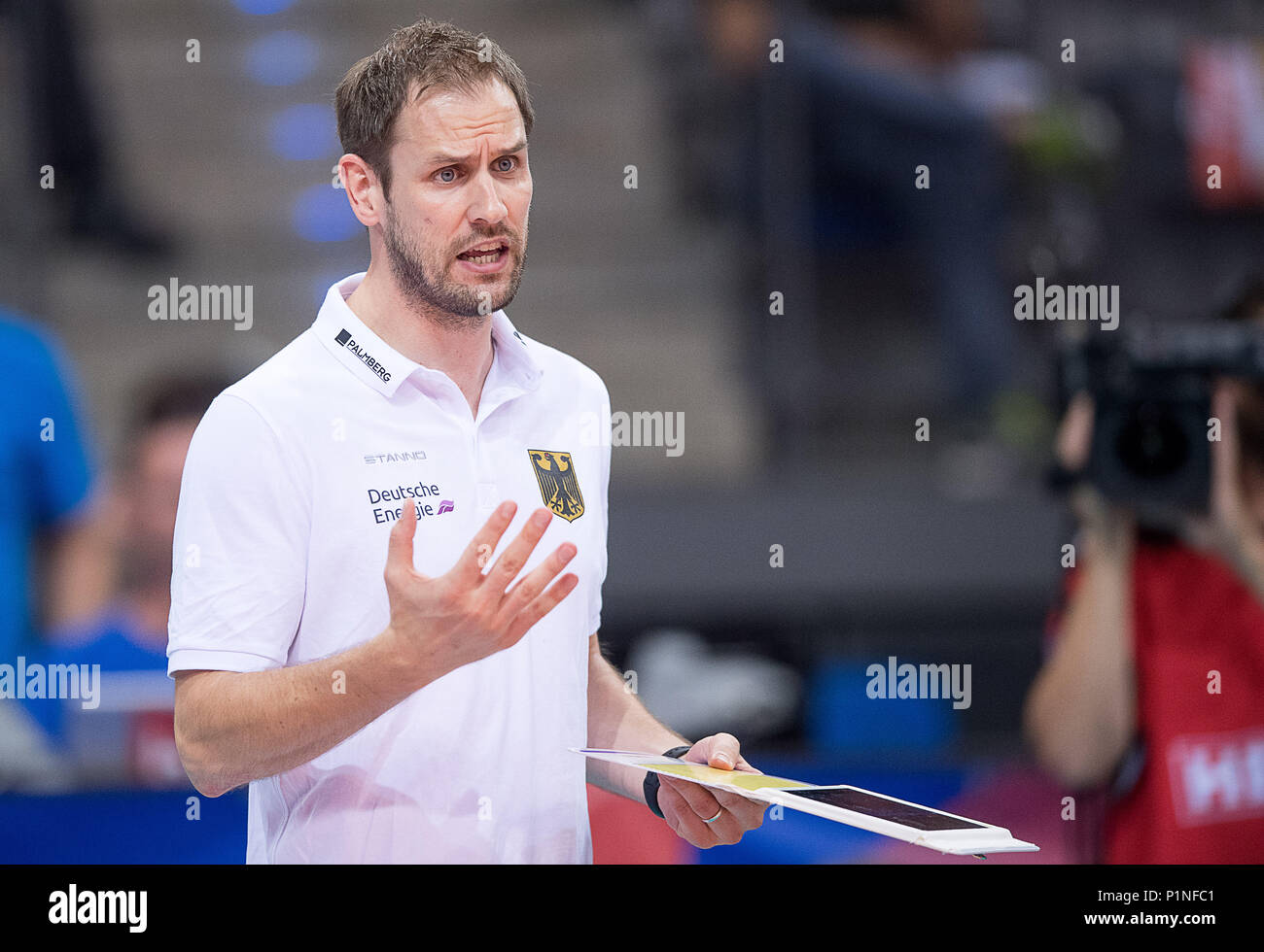12-june-2018-germany-stuttgart-volleyball-womens-nations-league-match-between-germany-and-china-at-the-porsche-arena-germanys-head-coach-felix-koslowski-at-the-volleyball-nations-league-gesticulates-at-the-sideline-photo-sebastian-gollnowdpa-P1NFC1.jpg