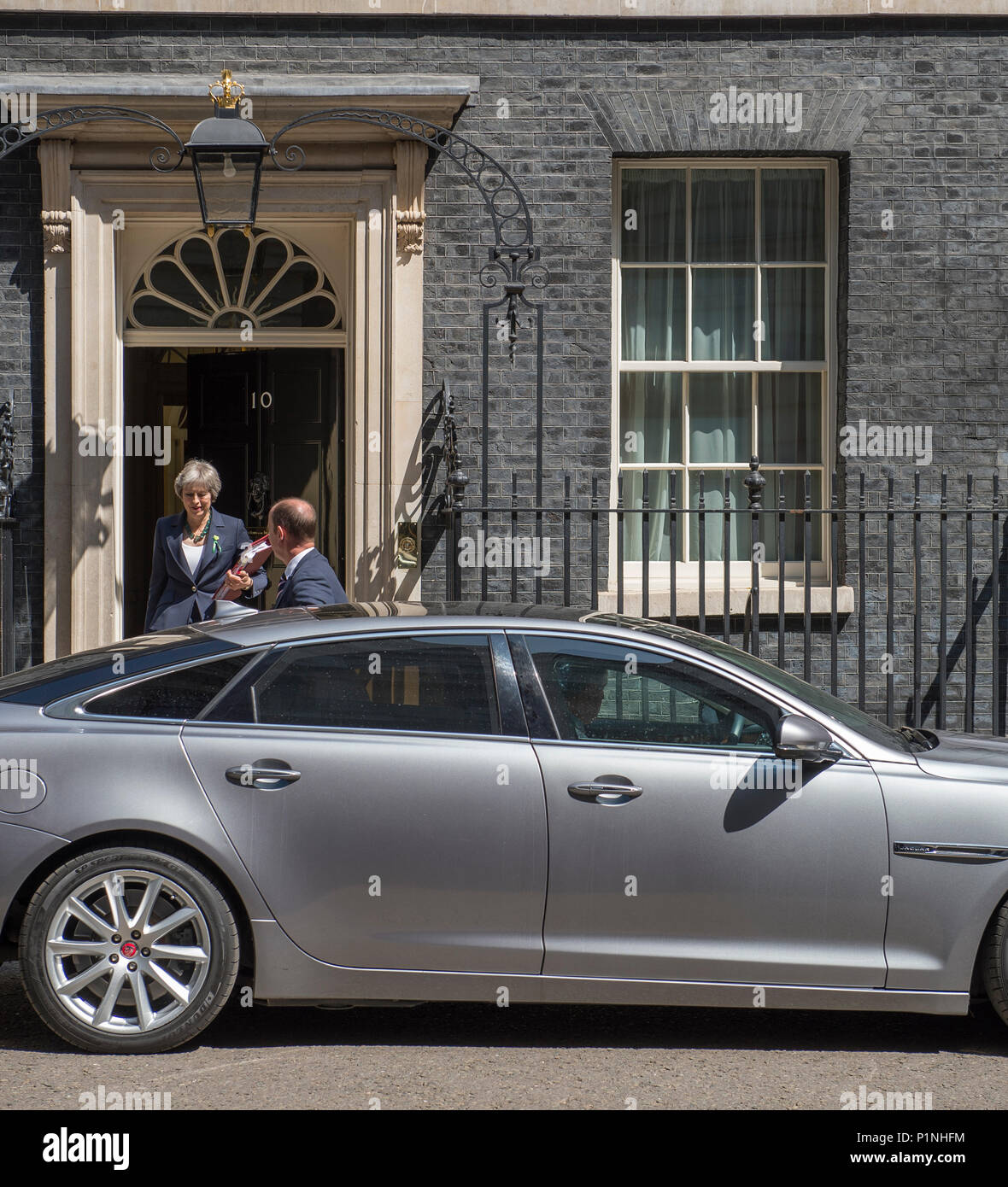 10 Downing Street, London, UK. 13 June, 2018. British Prime Minister Theresa May leaves 10 Downing Street on her way to Parliament attending Prime Minister's Question Time which takes place at 12 noon on Wednesdays. Credit: Malcolm Park/Alamy Live News. - Stock Image