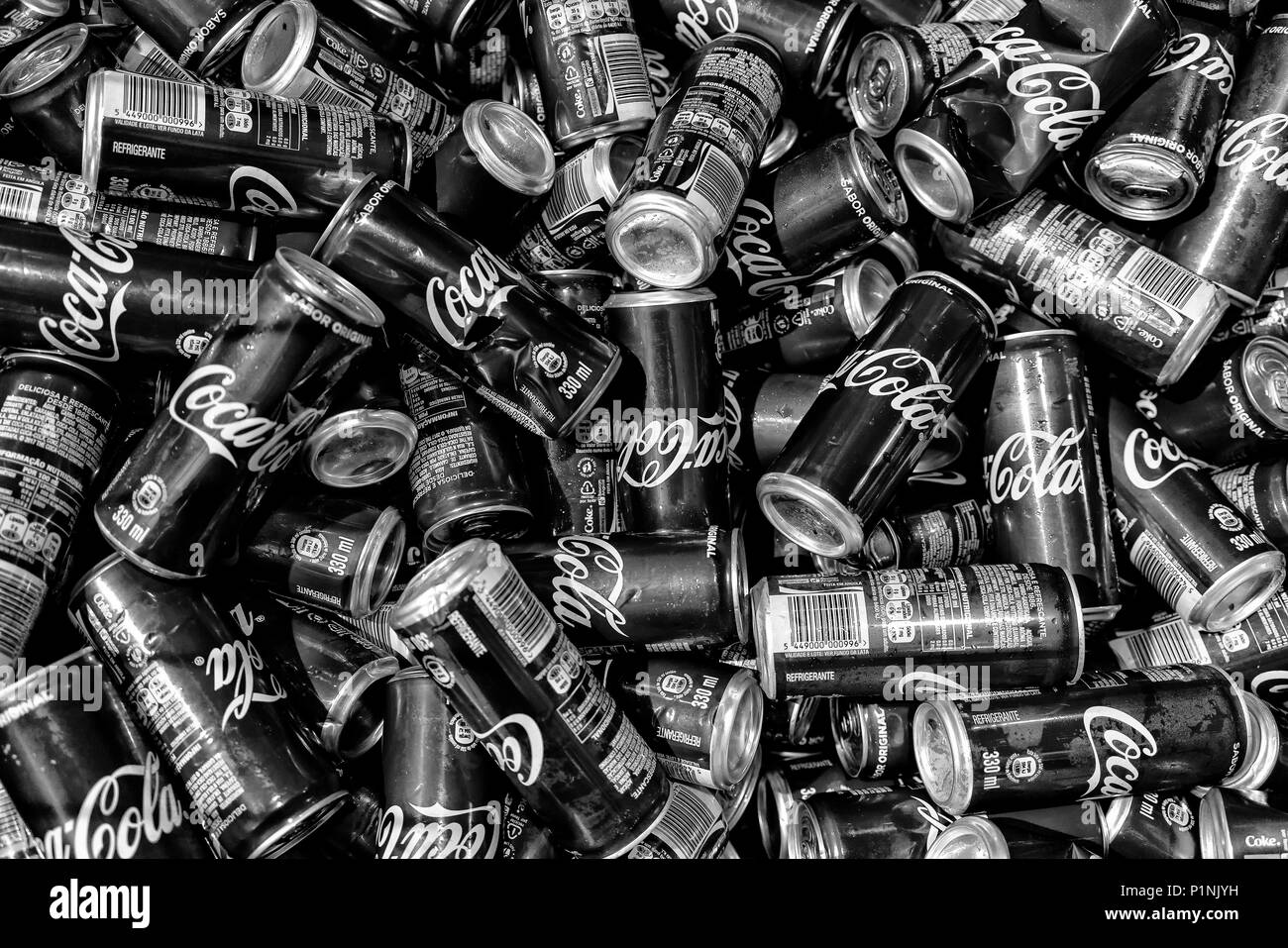 LUANDA/ANGOLA 23 MAY 2018 - Coke ready for recycling cans bw version - Stock Image