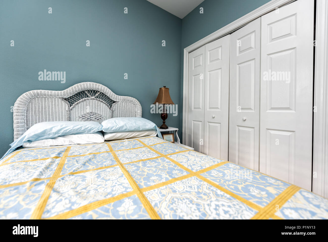 New Clean Bed Comforter With Headboard Table Lamp Vintage Beach Theme Decorative Blue Green Pillows In Bedroom In Staging Model Home House Or Apar Stock Photo Alamy