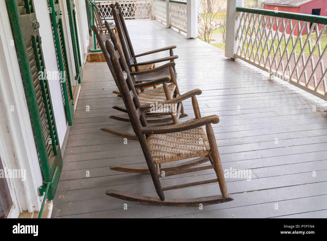 Old Wooden Rocking Chairs The On Porch Of A Farmhouse Stock Photo