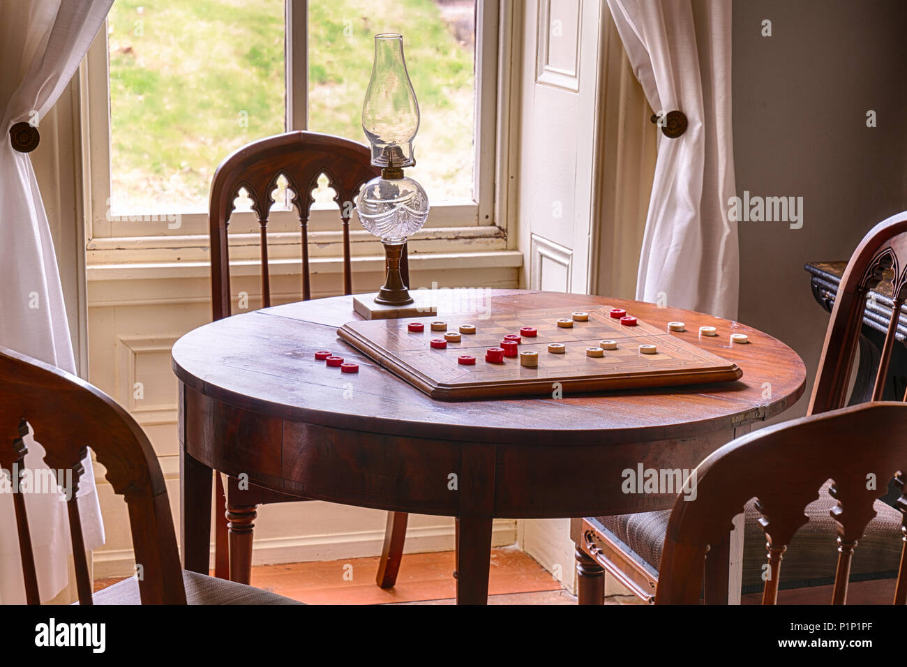 Checkers Game Set Up On a Table in a Historic Home Stock Photo