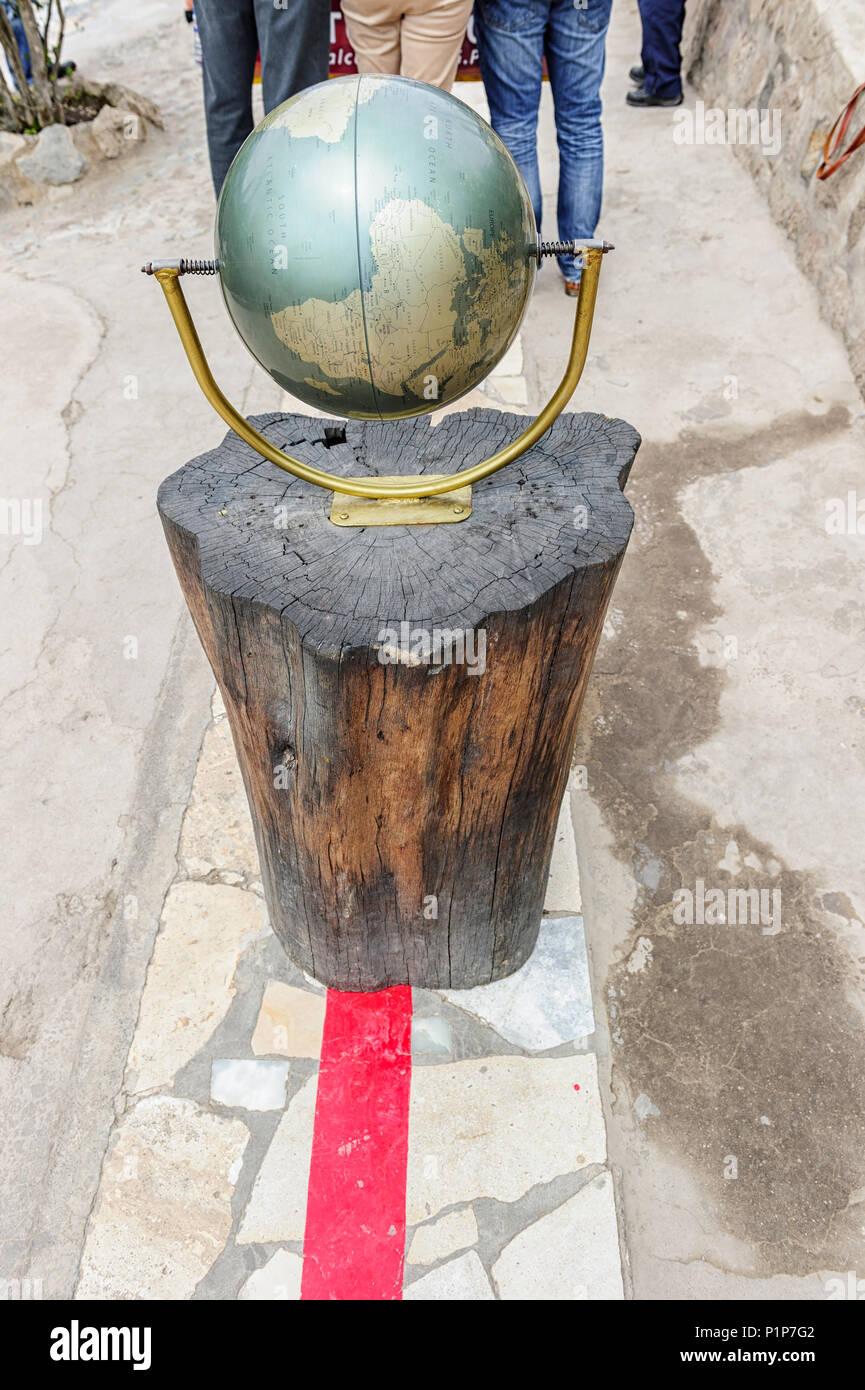 The red line marks the exact placement of the equator at the Intiñan Solar Museum,  San Antonio de Pichincha near Quito Ecuador - Stock Image