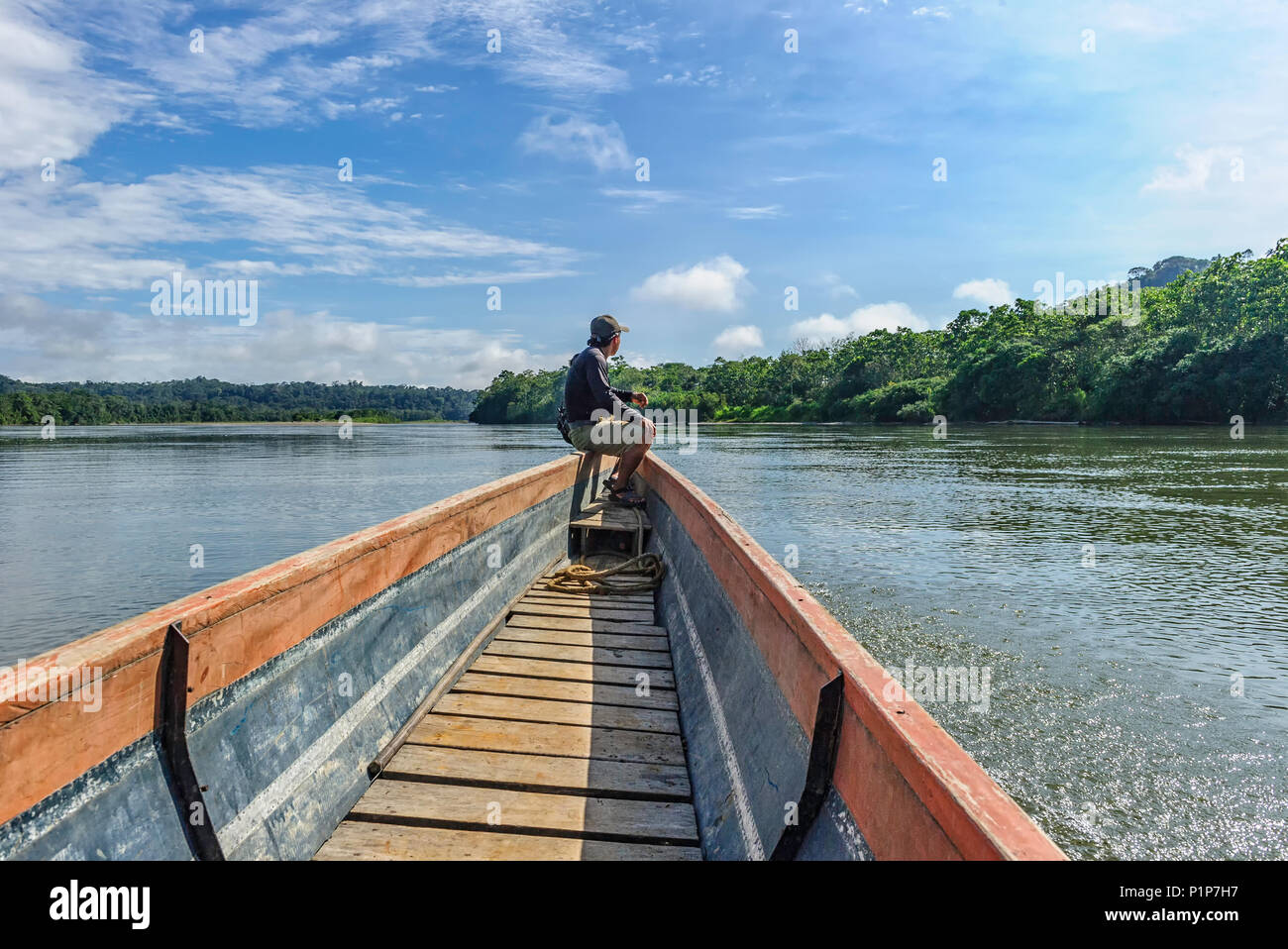 Man piloting a transport canoe on the Napo River Ecuador - Stock Image