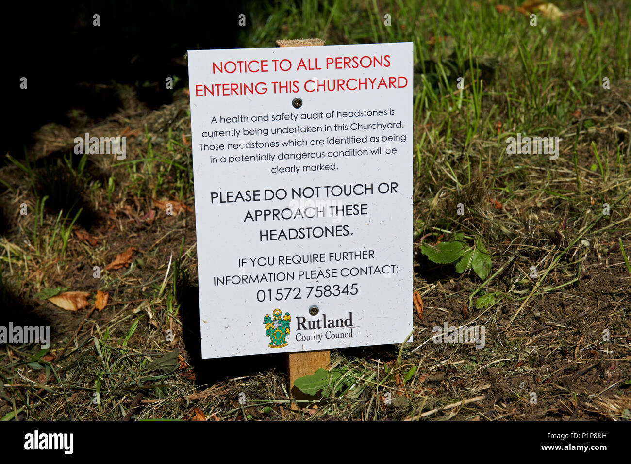 Notice in the churchyard, warning visitors that some headstones are unsafe, England UK - Stock Image