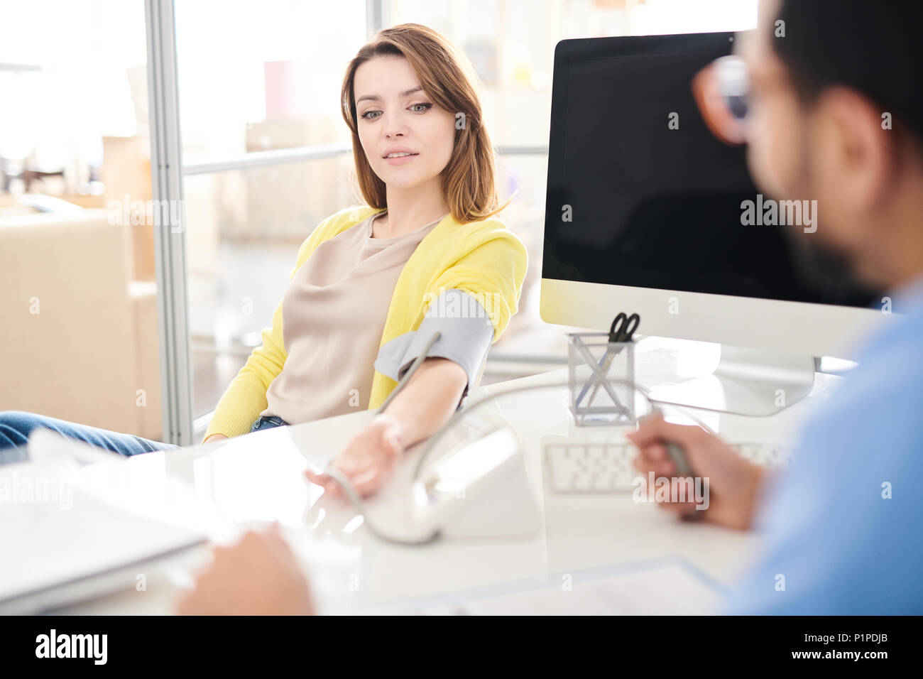 Female Patient in Modern Clinic - Stock Image