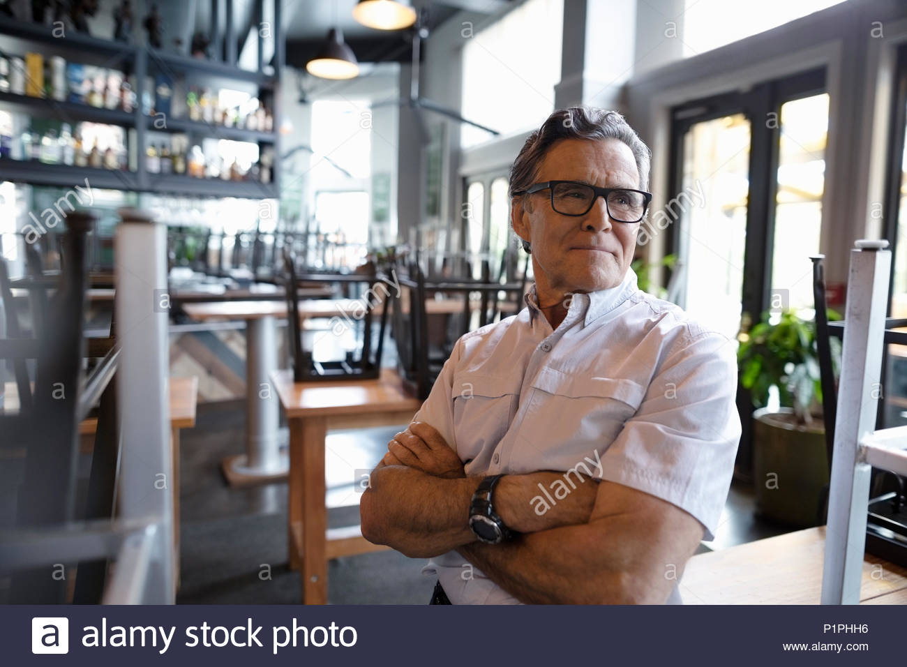 Confident senior restaurant owner - Stock Image