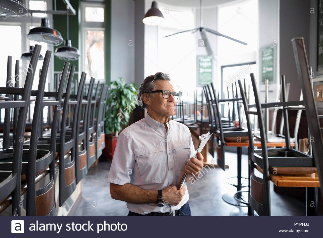 Senior restaurant owner - Stock Image