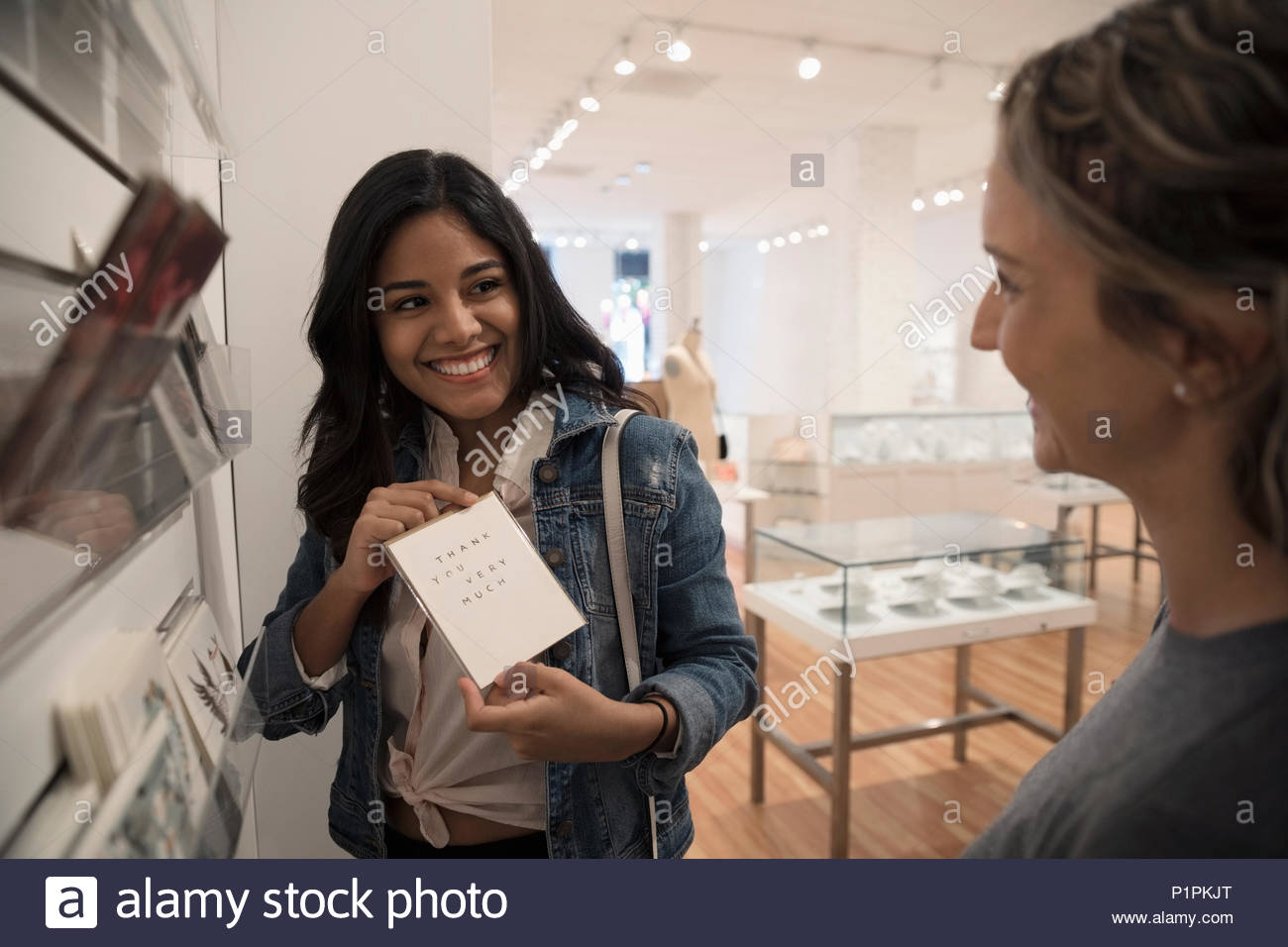 Women Friends Shopping For Greeting Cards In Boutique Stock Photo