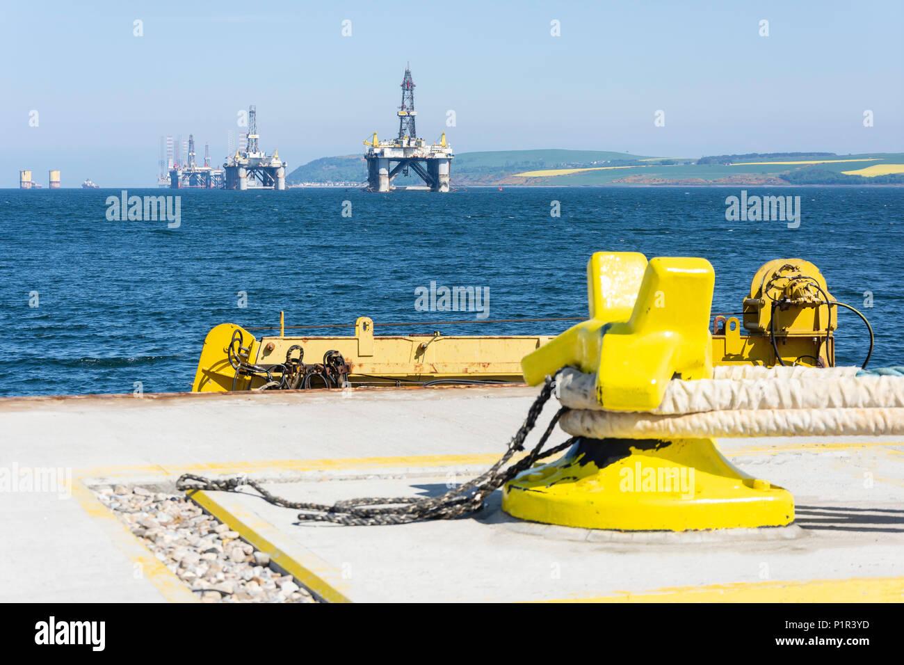 Oil rigs anchoured in the Cromarty Firth, Invergordon, Highland, Scotland, United Kingdom - Stock Image