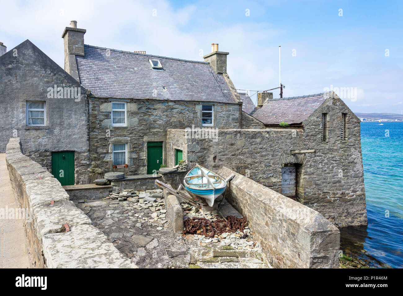 Stone cottage in harbour (Jimmy Perez house in TV Shetland series), Lerwick, Shetland, Northern Isles, Scotland, United Kingdom - Stock Image