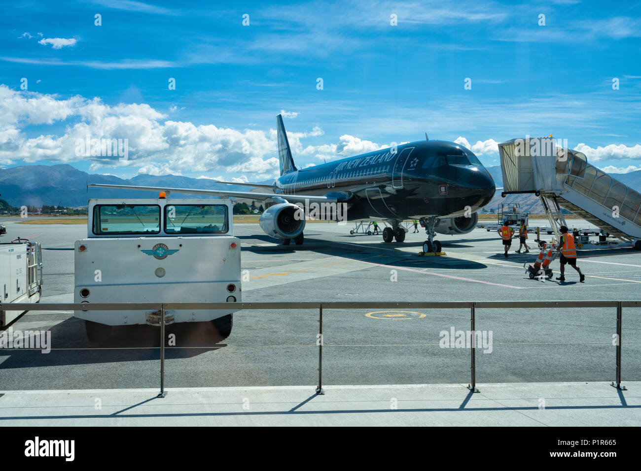 Queenstown, New Zealand - January 19, Air New Zealand Black Livery Airbus being prepared for takeoff at Queenstown Airport - Stock Image