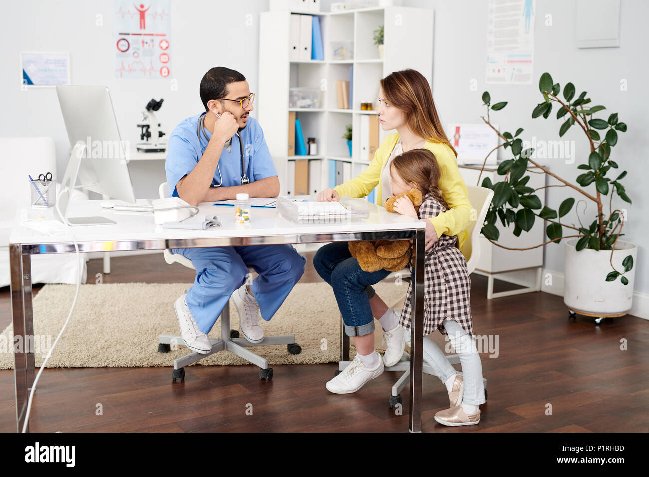 Family Visiting Doctor - Stock Image