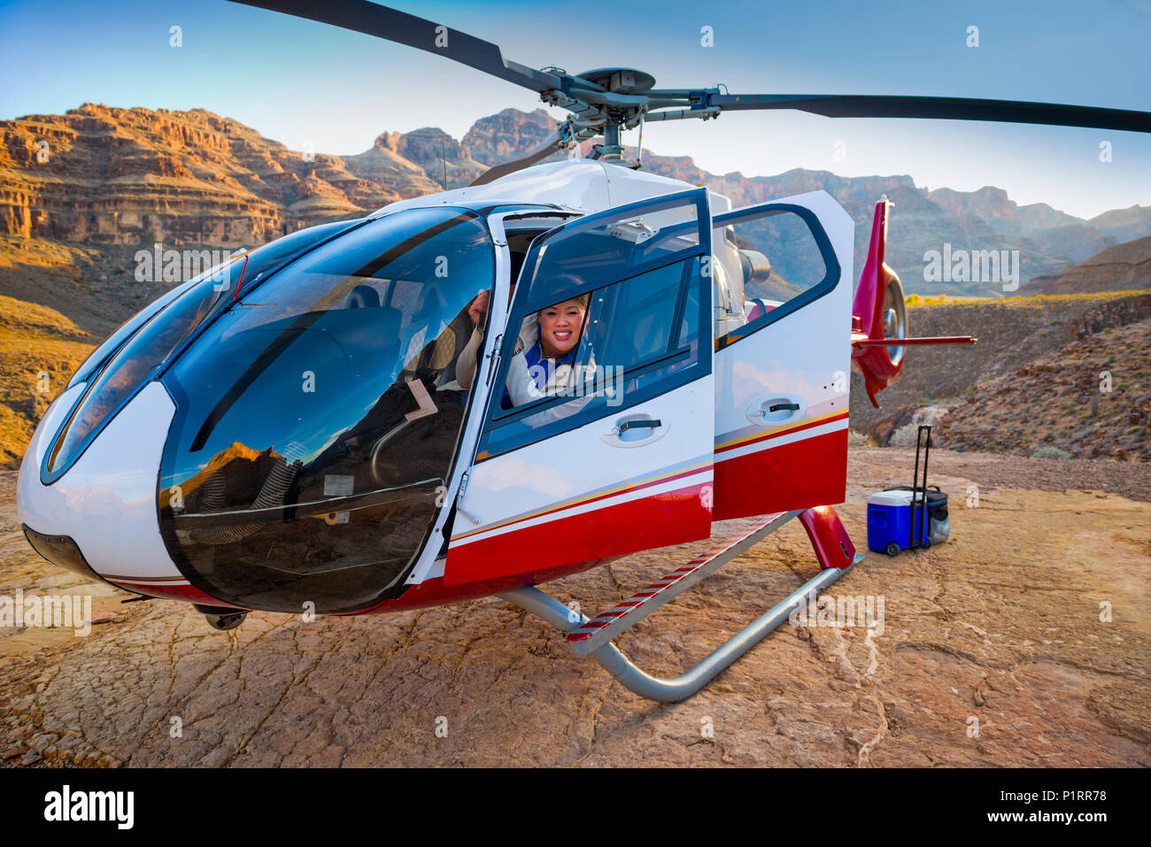 Woman posing in a landed helicopter on a Grand Canyon scenery tour; Las Vegas, Nevada, United States of America - Stock Image