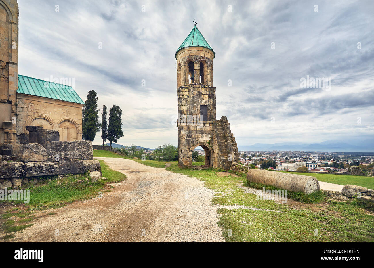 Bell Tower in front of Bagrati church at overcast sky in Kutaisi, Georgia - Stock Image
