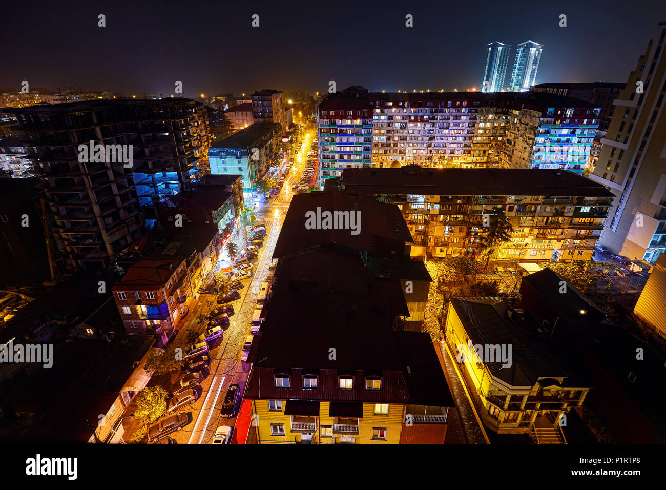 BATUMI, GEORGIA – OCTOBER 3, 2017: Night streets of city with illumination. View from the roof of skyscraper. - Stock Image