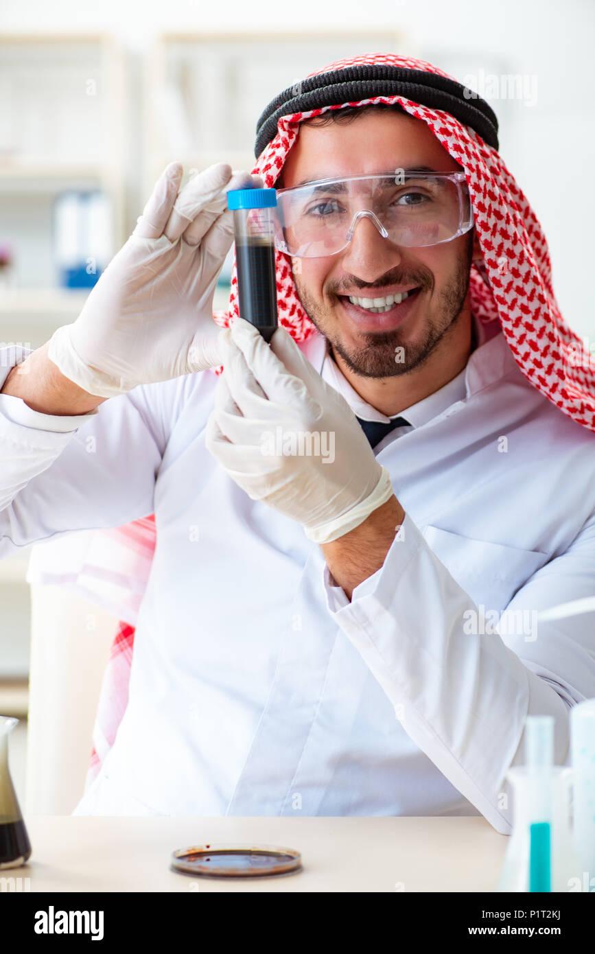 arab-chemist-scientist-testing-quality-of-oil-petrol-P1T2KJ.jpg