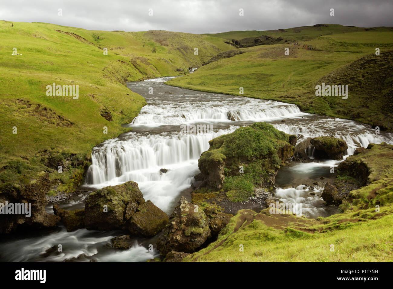 Skógá River falls over cascade waterfall, Skógar, South Region, Iceland - Stock Image