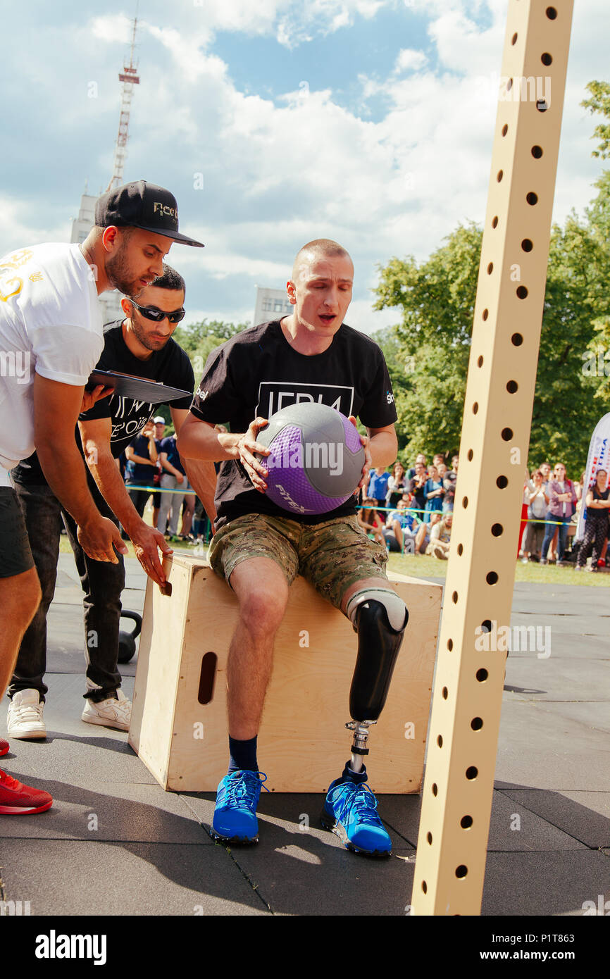 "under the brand name ""games for heroes"" - the stage of the sports crossfit of all Ukrainian competitions for veterans of the war in Kharkov on June 9, Stock Photo"