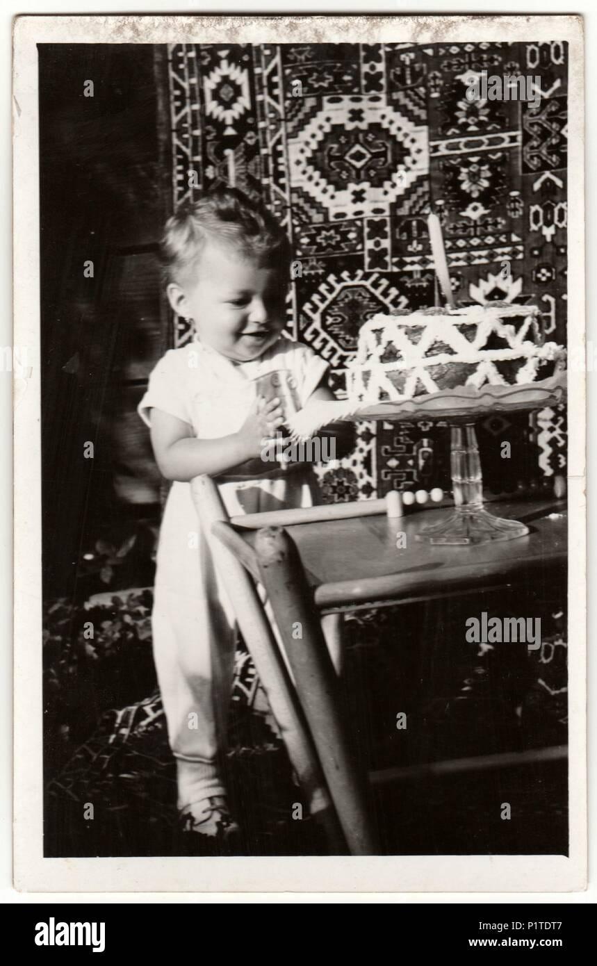 The czechoslovak socialist republic circa 1960s vintage photo shows a boy to celebrate his first birthday birthday cake for boy retro black white