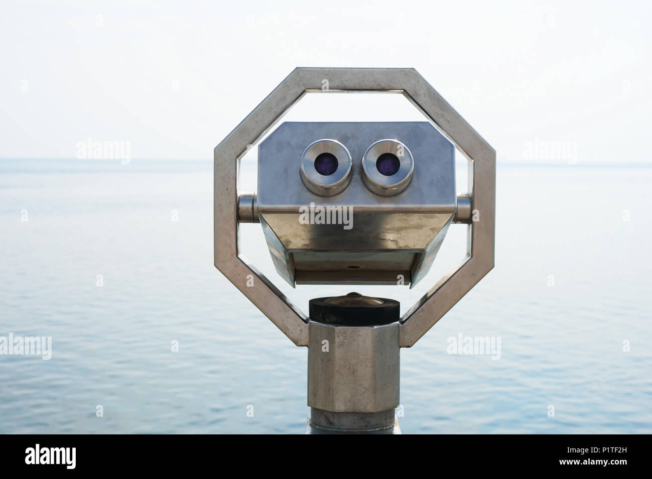 seaside overlook with coin-operated binoculars, travel vacation and observation concept - Stock Image