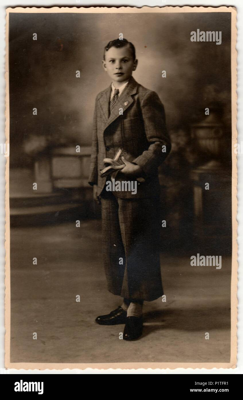 Zedelgem belgium circa 1920s vintage photo shows boy poses in a photography studio retro black white photography